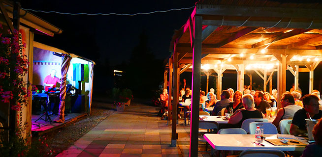 Group of guests during a lotto Bingo evening, activity organized at the campsite Les Castors in Alsace