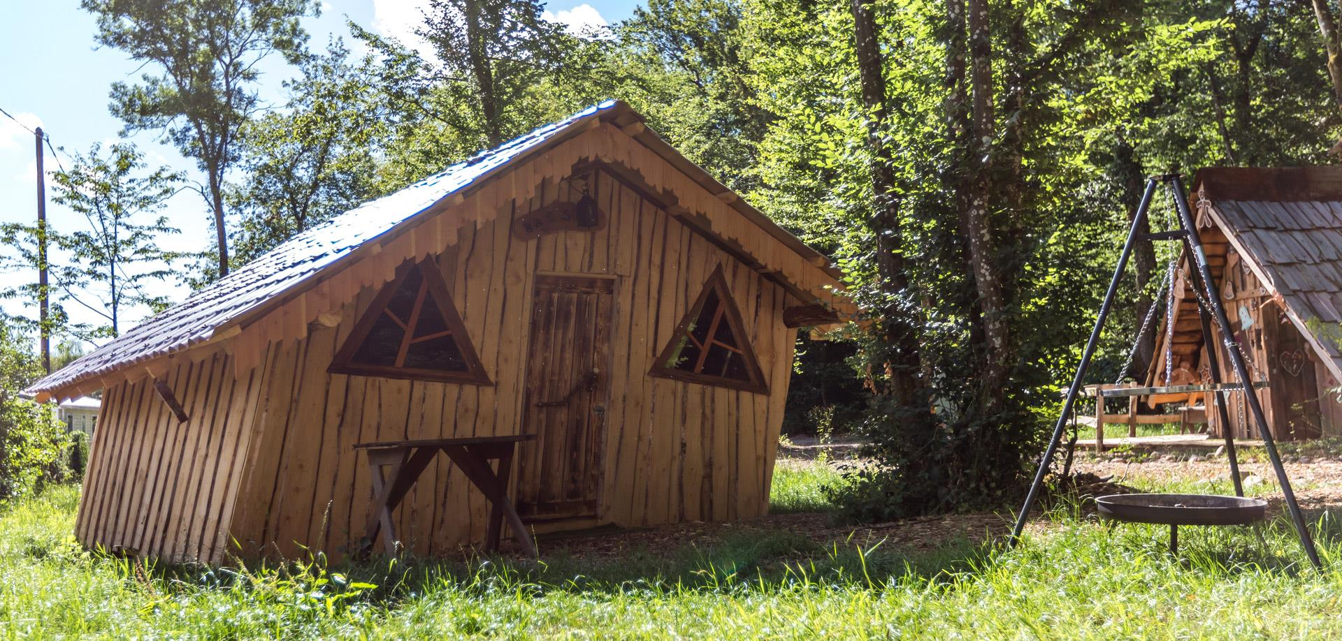 Outside view of the Wooden Hut of Hansel rental of atypical cabins in the Haut-Rhin at the Campsite Les Castors